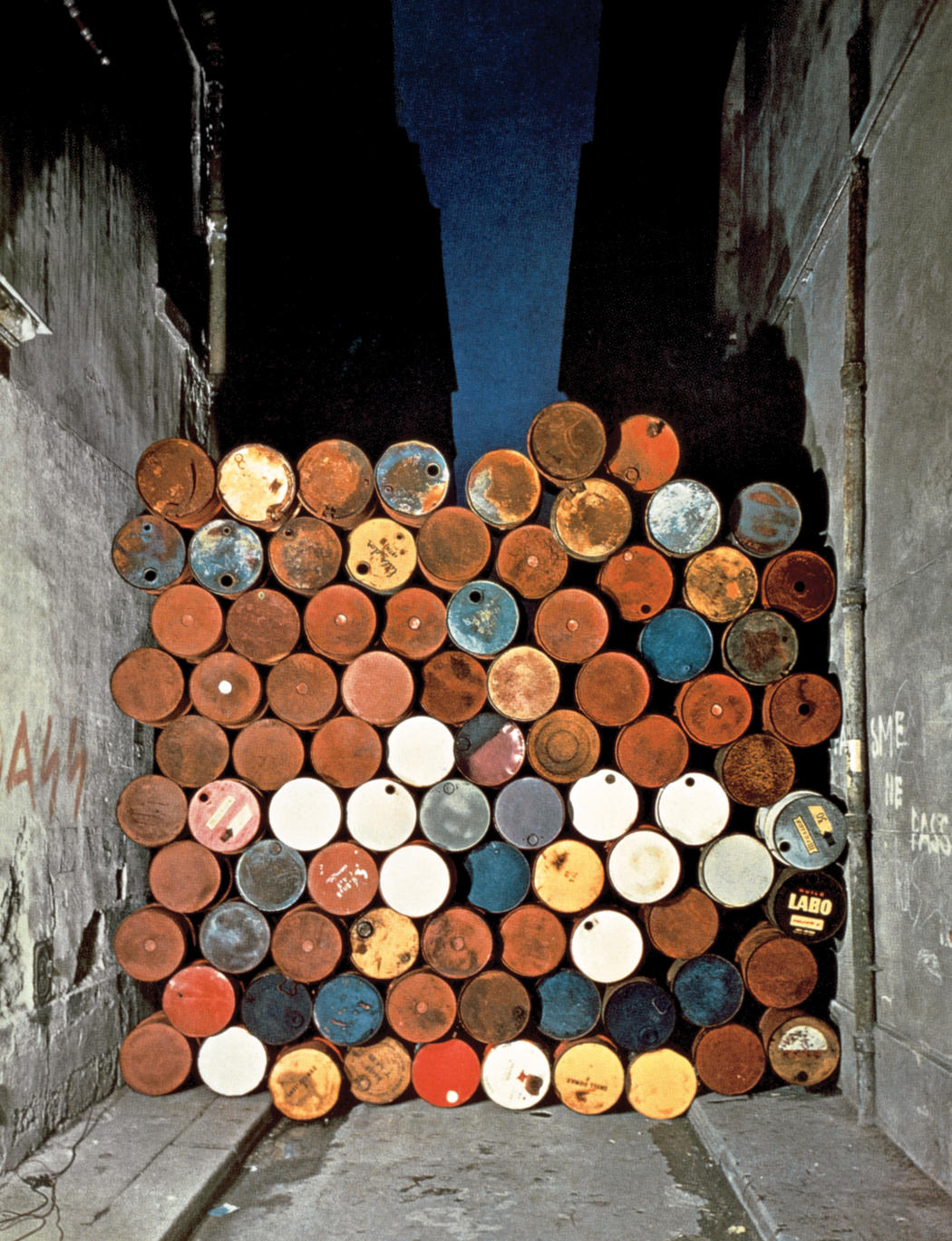 Christo and Jeanne Claude Wall of Oil Barrels   The Iron Curtain, Rue Visconti, Paris, 1961-62. Photo  Jean-Dominique Lajoux  1962 Christo