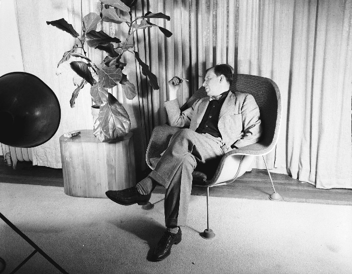 Eero Saarinen seated in a prototype of his Womb Chair. 1947. Photograph  Harvey Croze.