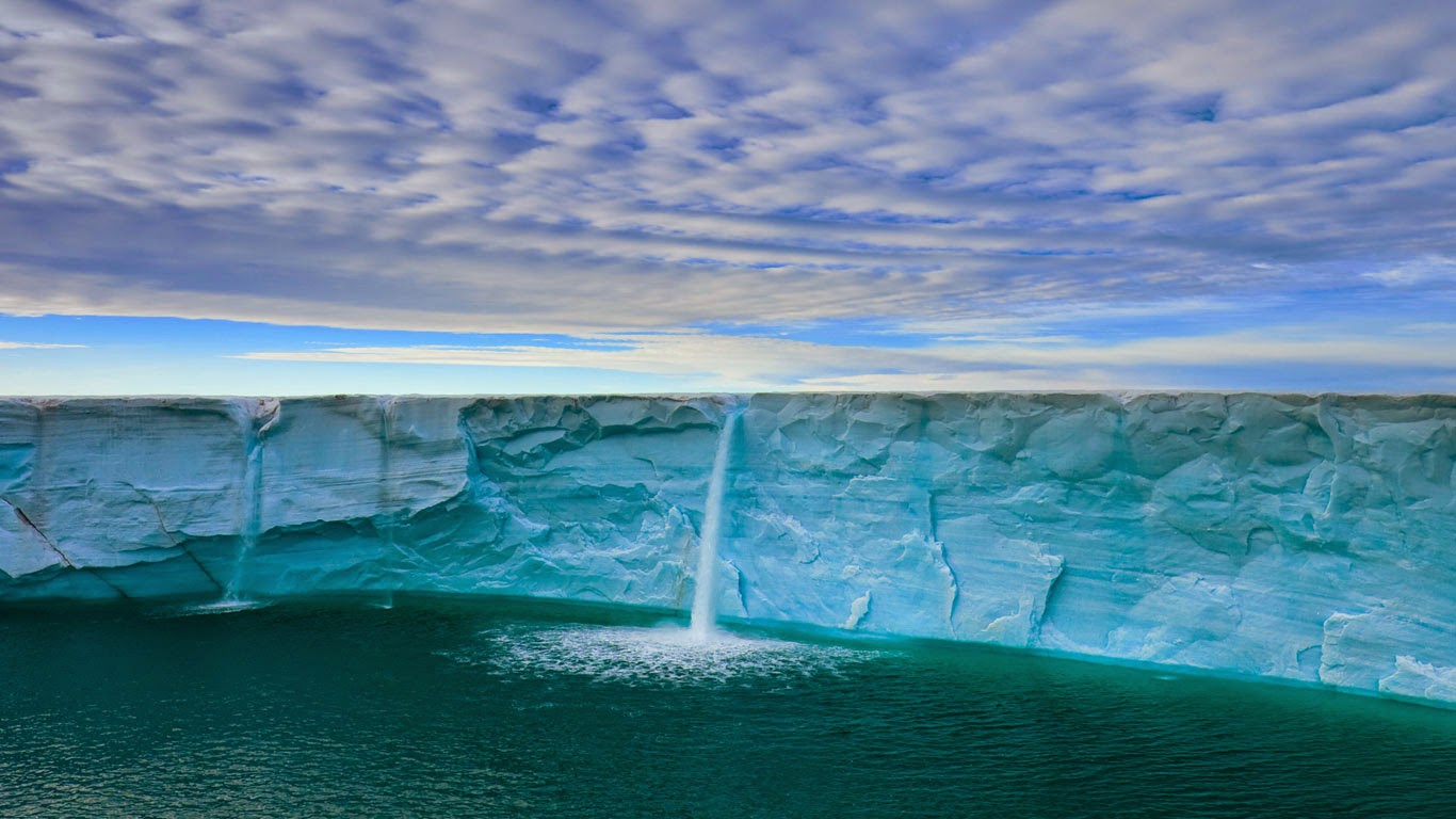 Meltwater creates waterfalls, Svalbard.
