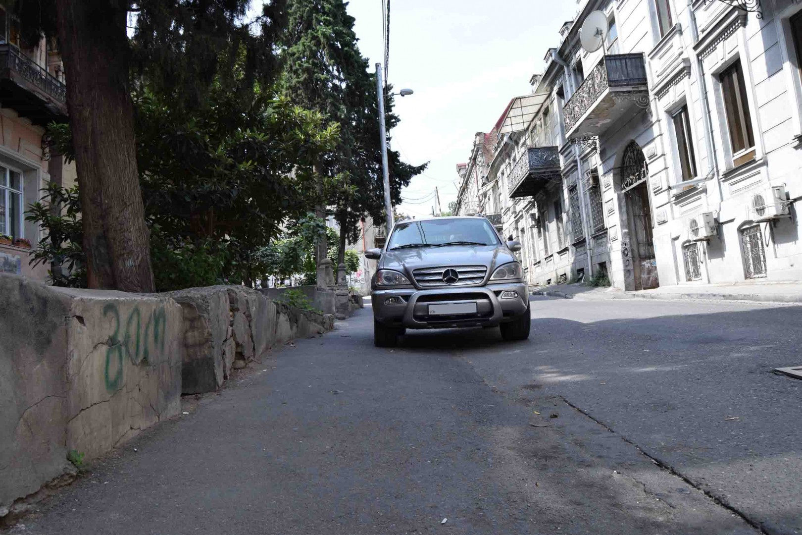Tbilisi. Lado Asatiani street Pavement doesn't even have dividing border from the road.