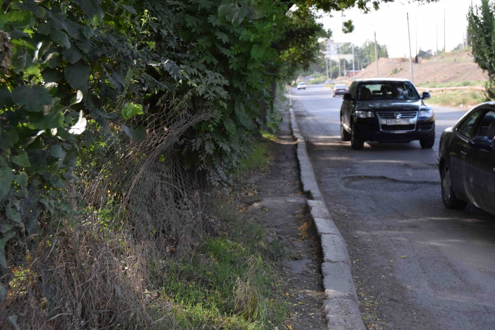 """Surrounding area of 31 Factory in Tbilisi suburbs and another non-functional sidewalk. Currently, the employees have to use the edge of the road to get to the work, because walk on this """"pavement"""" is almost impossible."""